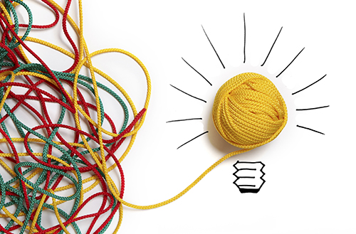 Bunched up twine leading to lightbulb