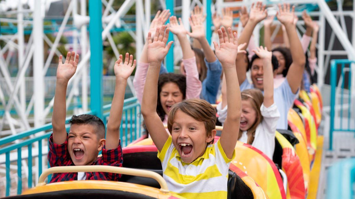 People having fun on a rollercoaster ride