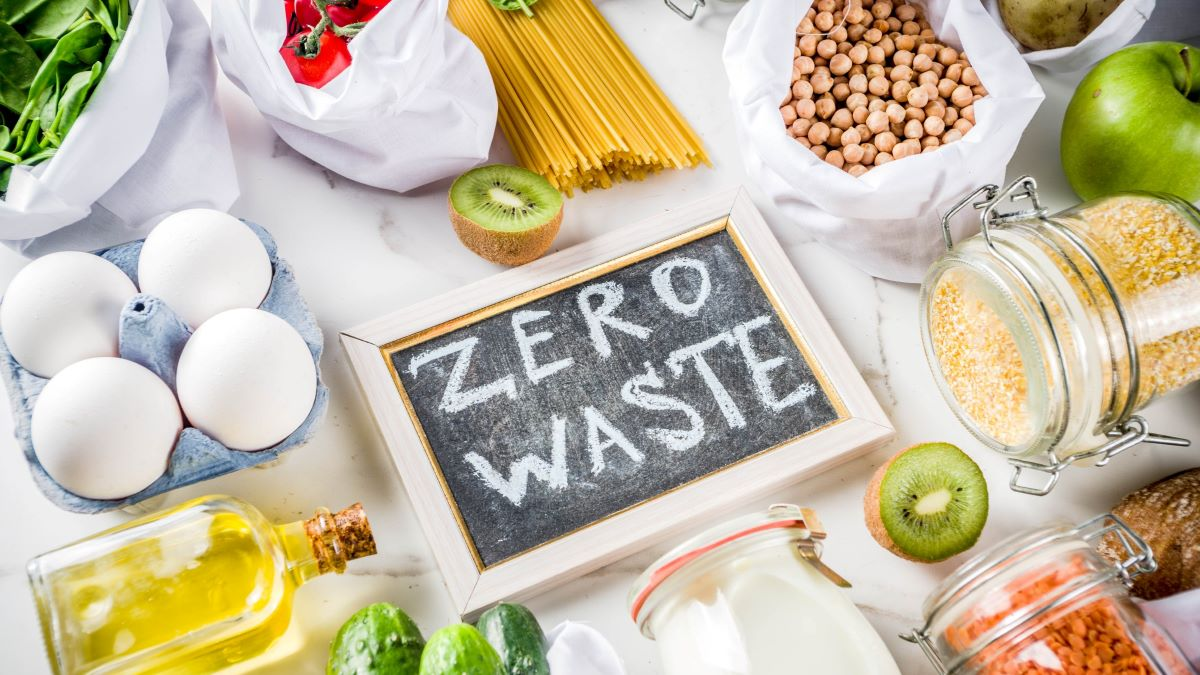 Food surrounding a zero waste sign on a blackboard