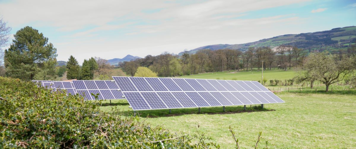 array of solar panels in a field in Wales