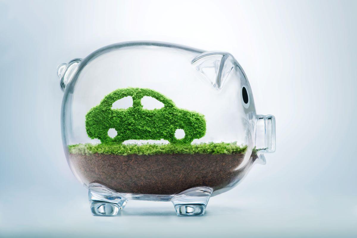 green car inside a piggybank