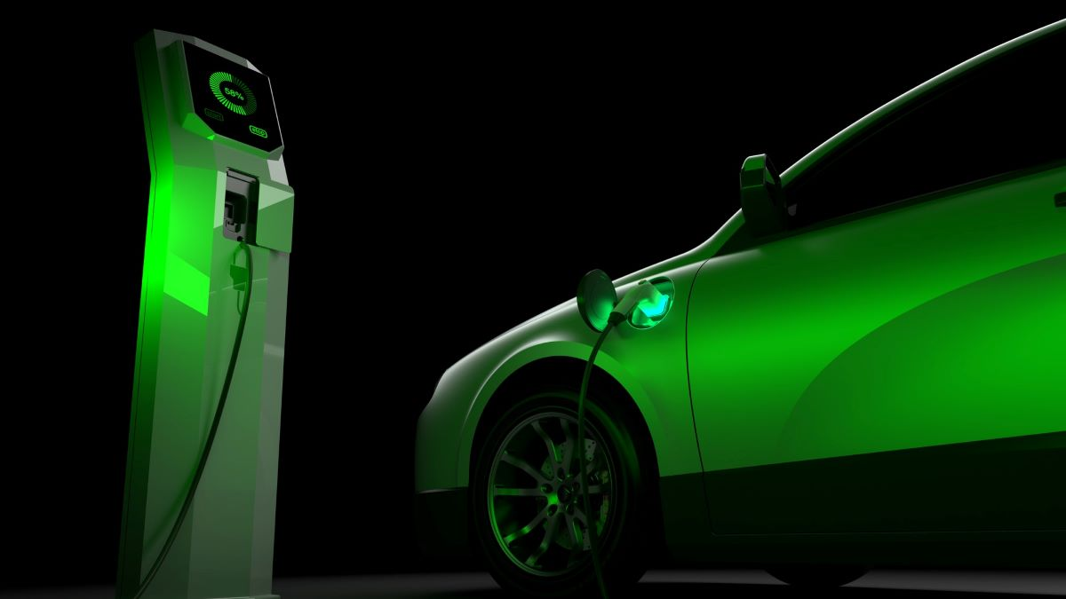 electric vehicle with charging station lit up in green light