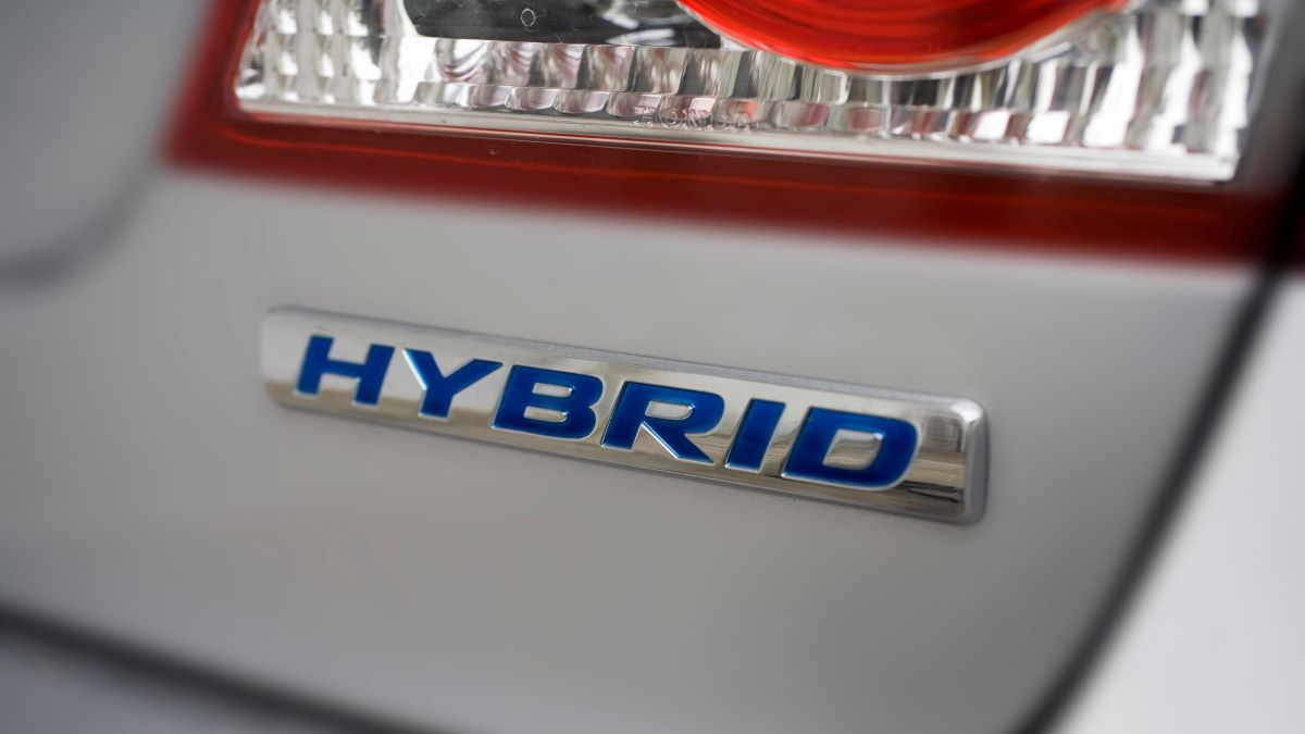 close up on the word hybrid on a vehicle