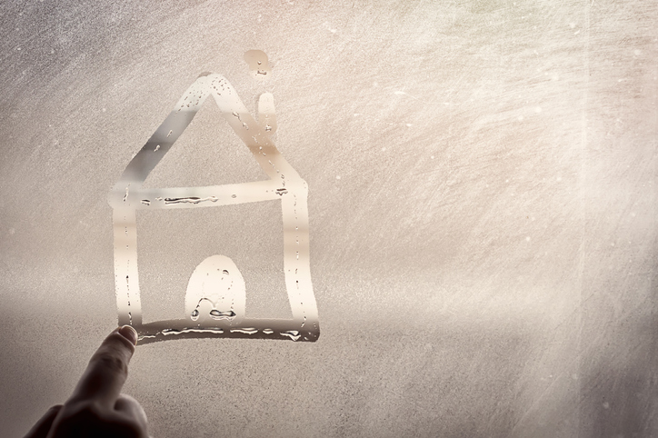 drawing of a house in water vapour on a window