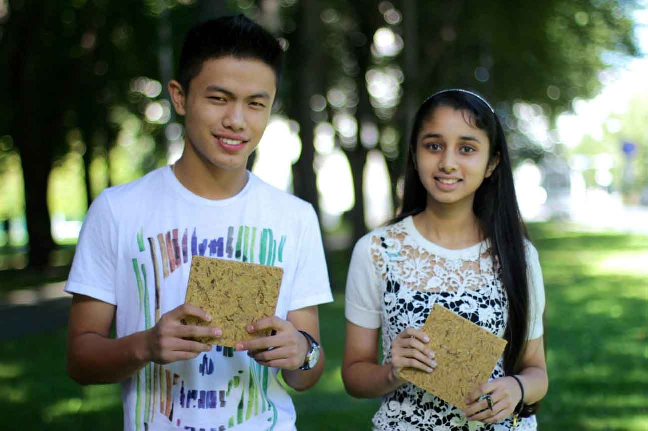 Rayvin Thingnam and Bisman Deu holding Green Wood, made from rice waste