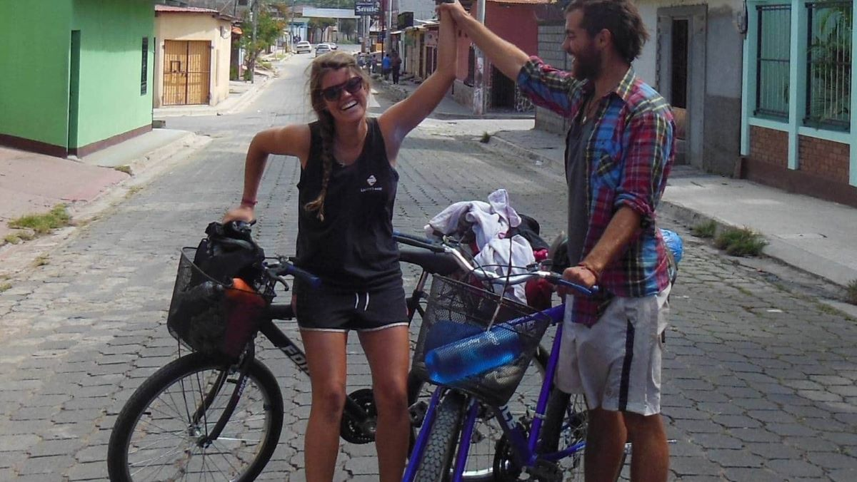 Stephi and friend with bikes in street