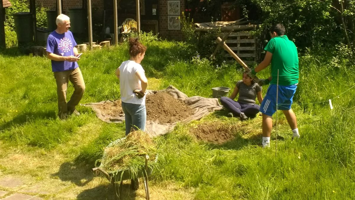 volunteers digging in the garden