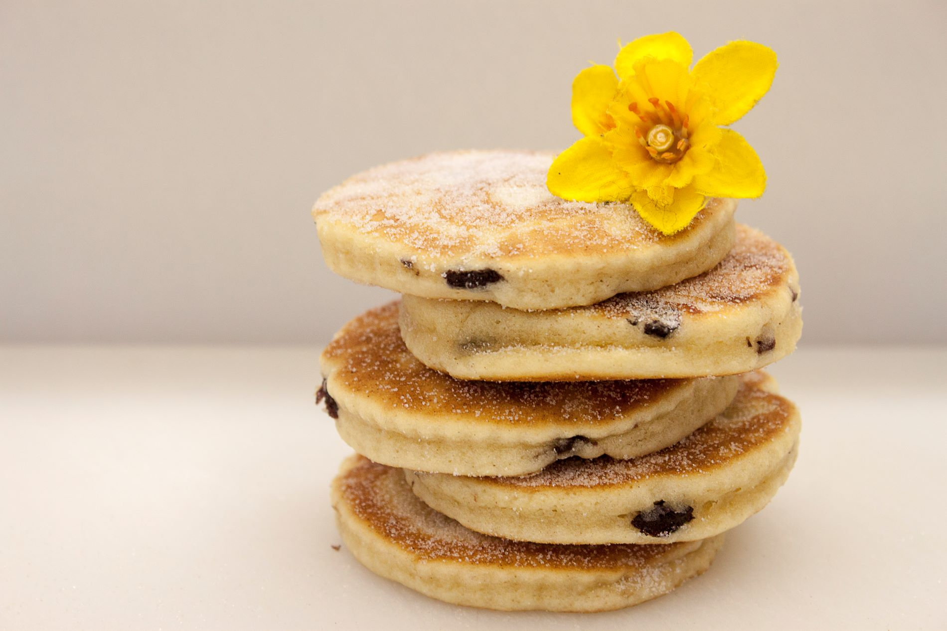 Welsh cakes in a stack with a daffodil