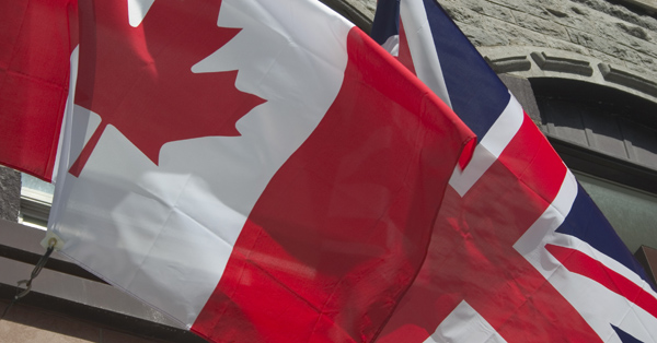 canada and uk flags flying together