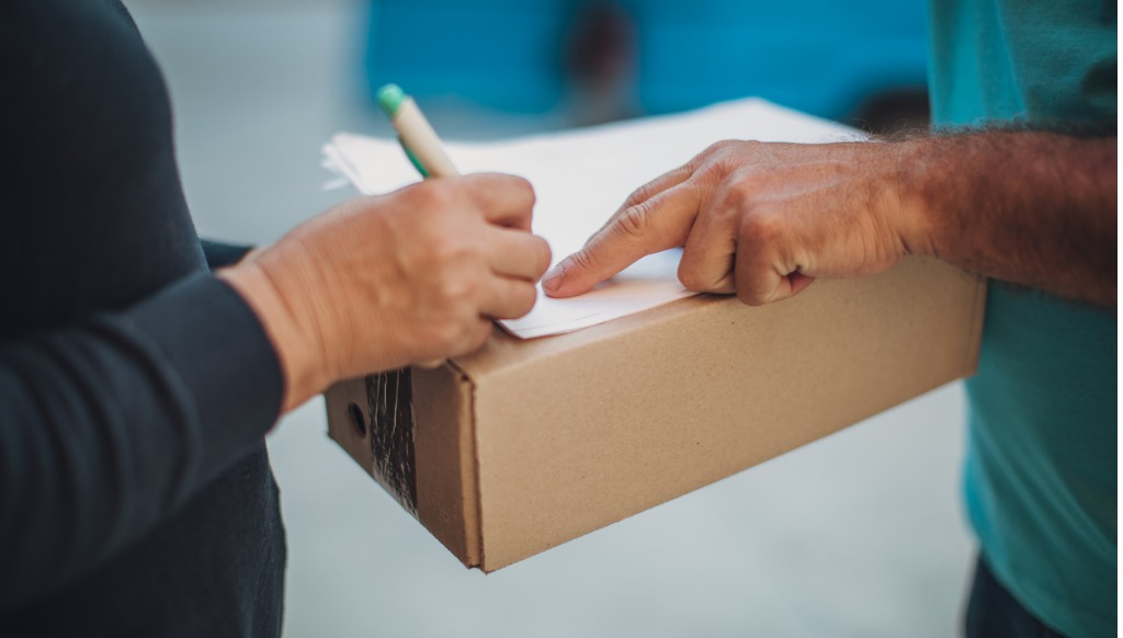 woman signing for a delivery