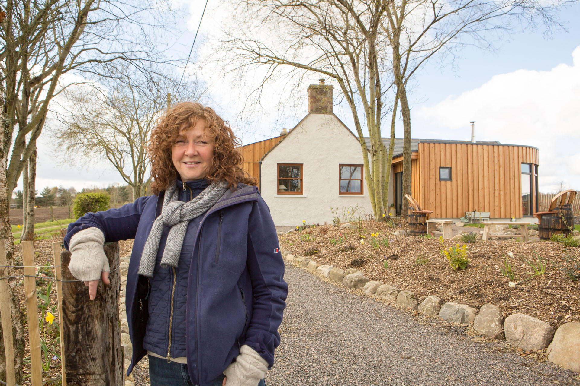 Caroline renewables user outside her home