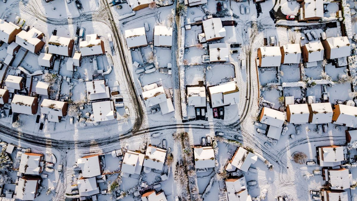Aerial view of UK  homes covered in snow
