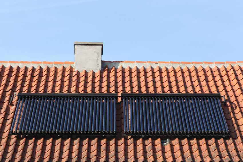 Solar thermal heating pipes on a roof