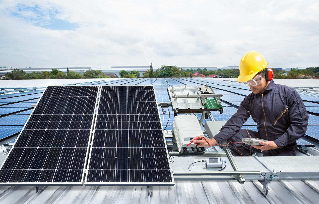 engineer repairing a solar panel
